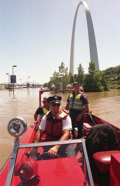 The water patrol floats down an overfull Mississippi River during the Great Flood of 1993.