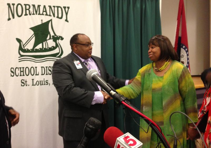 Normandy Superintendent Ty McNichols speaks with a parent following the press conference.