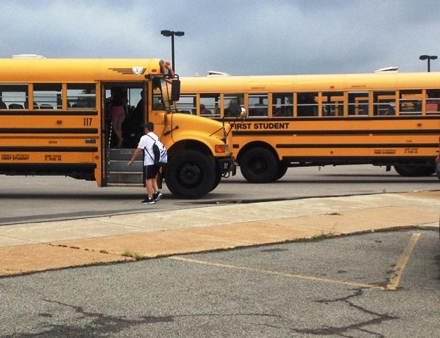 Buses at Hollenbeck Middle School in the Francis Howell School District prepare to take students home after the first day of school.