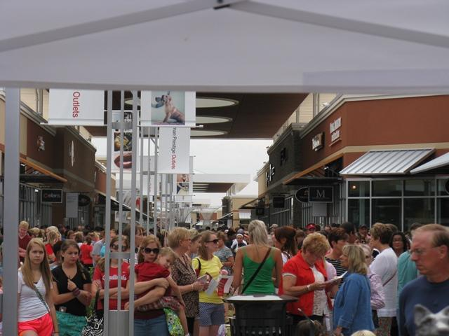 Crowds await the official opening of the Taubman Prestige Outlets in the Chesterfield Valley.