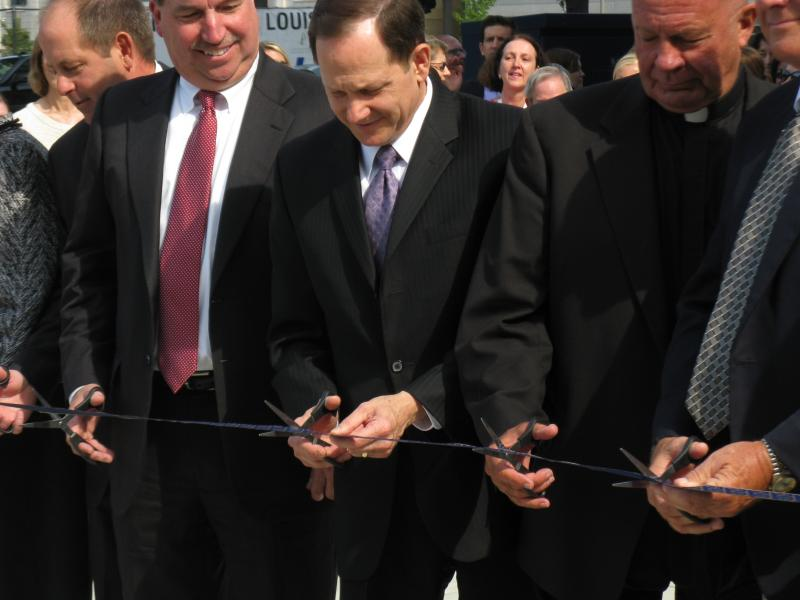 Developer Steve Smith, Mayor Francis Slay, and Father Lawrence Biondi cut the ribbon on the new SLU law school in downtown St. Louis on April 16, 2013.