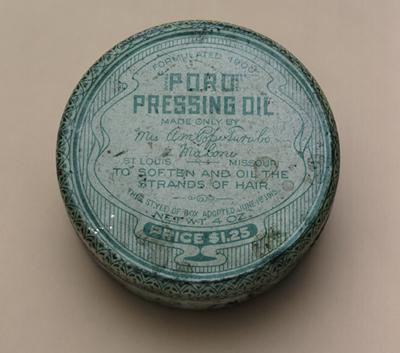 Poro Pressing Oil tin, part of the line of hair care products developed by African American entrepreneur Annie Malone. One of the 50 objects in the 250 in 250 Exhibit.
