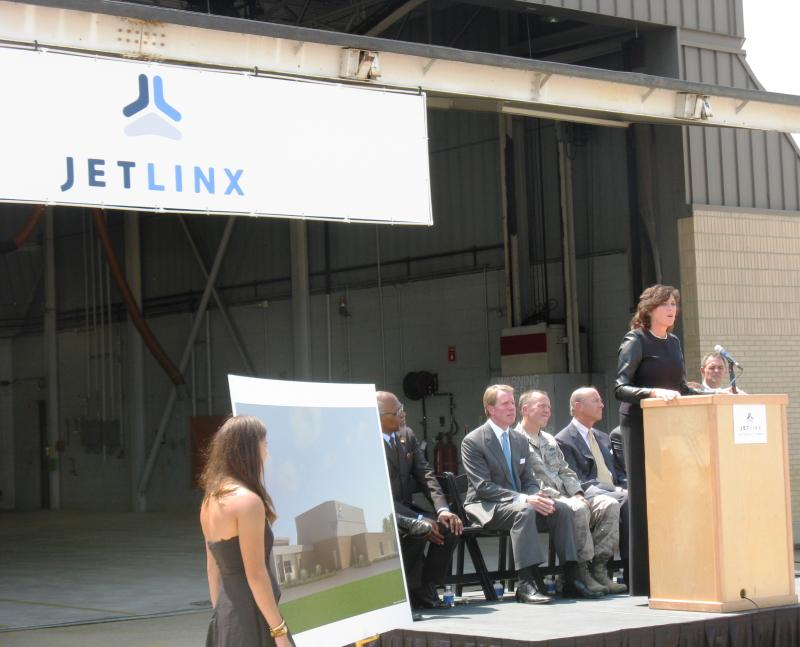 With local business and political leaders watching, Lambert Airport director Rhonda Hamm-Niebruegge speaks about the arrival of JetLinx to St. Louis.