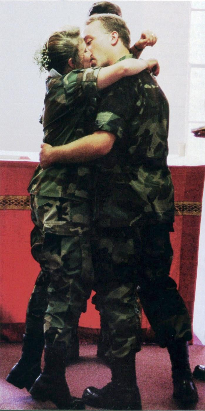 Robert and Christine Schuler Hurst make their August 9, 1993 wedding official with a kiss. The couple had been deployed to Festus with the Missouri National Guard.