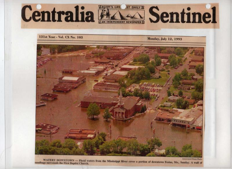 This Centralia Sentinel article from July 1993 shows the devastation the Mississippi River caused in Festus. Robert and Christine Hurst would both assist in the city's fight against the river.