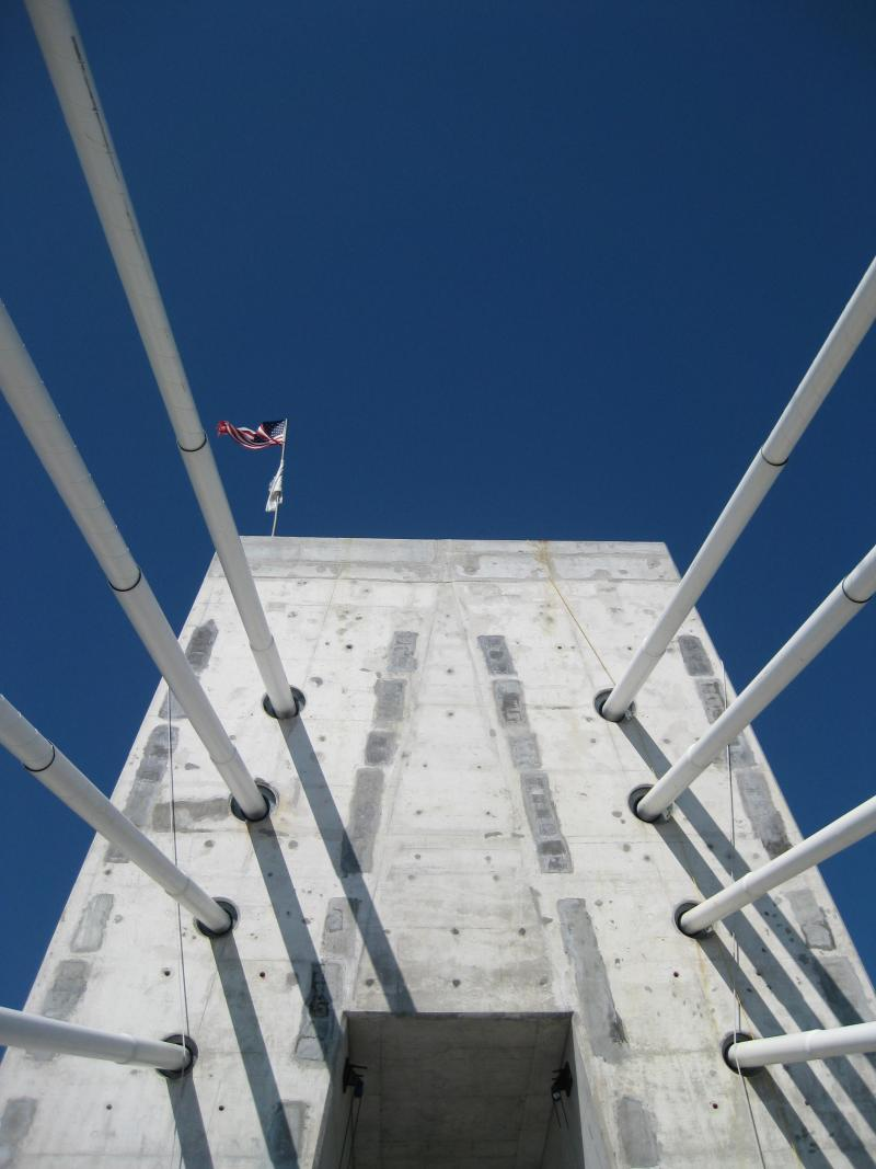 Looking skyward at the Missouri-side bridge tower. Perched atop it are an American flag and another flag memorializing the worker killed during the bridge's construction.