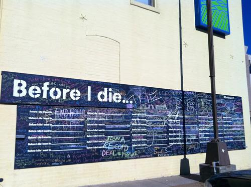 Before I Die wall on the side of the Delmar Loop Craft Alliance building.