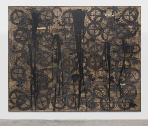 "Rashid Johnson, Houses in Motion, 2012. Branded red oak flooring, black soap, wax, and spray enamel, 96 5/8 x 120 5/8 x 2 3/8""."