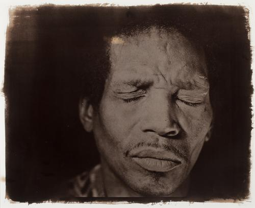 "Rashid Johnson, Jonathan with Eyes Closed, 1999. Toned silver gelatin print, 21 1/2 x 27 1/2""."