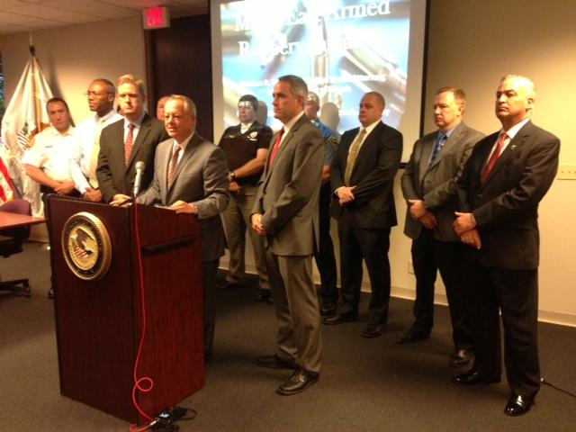 U.S. Attorney for the District of Southern Illinois Stephen Wigginton is surrounded by local Metro East law enforcement officials as he announced a new initiative targeting armed robbery