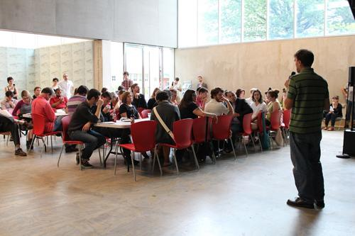 Matt Frederick presents his proposal for a Citizens Police Review Board to an attentive audience at Potluck PAC on September 15, 2013 at the Contemporary Art Museum.
