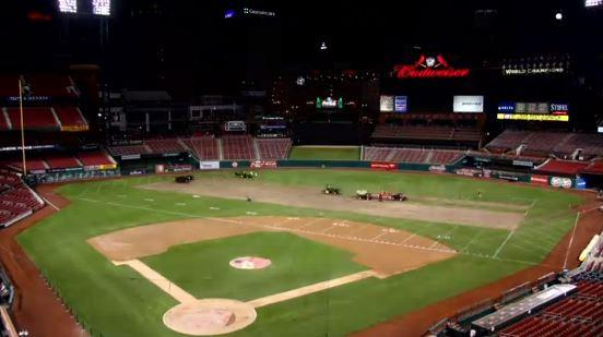 Grounds crews convert Busch Stadium's field back into baseball shape.