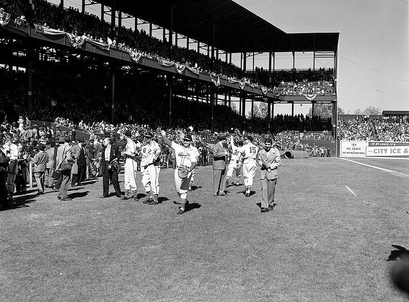 Members of the 1946 St. Louis Cardinals warm up before a World Series game against the Boston Red Sox at Sportsman's Park in St. Louis, Mo.