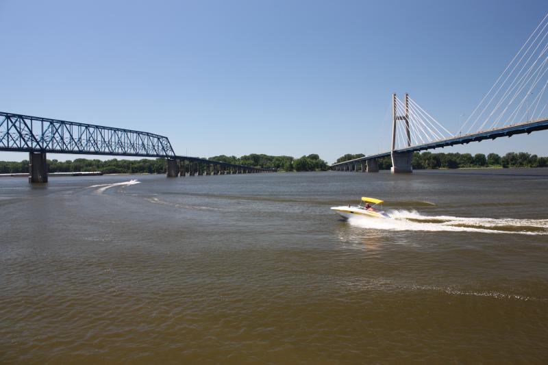 Boaters out on the Mississippi River at Quincy Bay in Quincy, IL. Missouri can be seen across the river. (Left: Quincy Memorial Bridge, Right: Bayview Bridge)