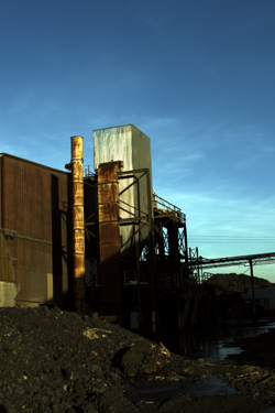 Chemetco refinery buildings and toxic slag waste piles taken prior to the start of cleanup operations.