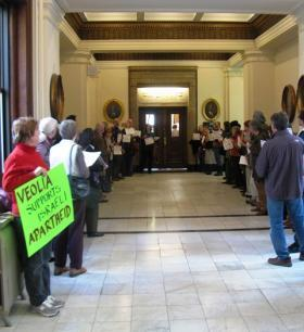 Protestors against Veolia gather in front of Mayor Francis Slay's office on January 16, 2013. The company announced today it will not sign a contract with the city.