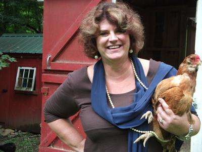 Ellen Stimson with Mabel the chicken.