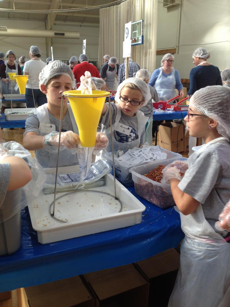 Students from St. Louis city and county schools assembled prepackaged meals to combat hunger in Tanzania and St. Louis