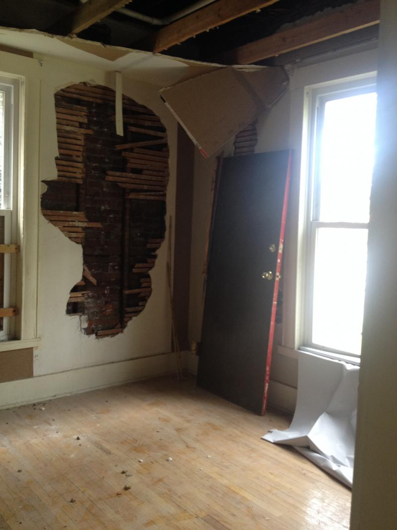 Several gaping holes have been struck in the home's walls. Vandals have stolen copper and wire over the years.