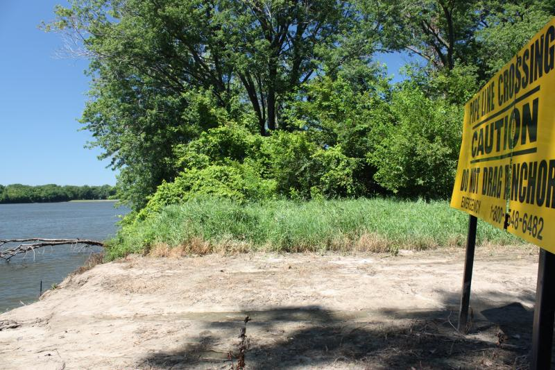 "Site of Enbridge's Spearhead Pipeline crossing in Canton Chute Recreational Area, located north of Quincy, Illinois in Adams County. Sign reads, ""Pipeline Crossing, Caution, Do Not Drag Anchor."""