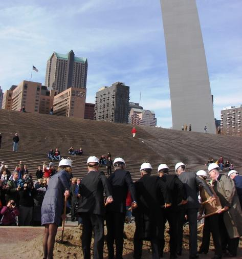 City officials and developers shovel soil in a ceremonial groundbreaking Thursday at the Riverfront Overlook Stage between the Gateway Arch and the Mississippi River.
