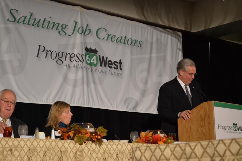 Nixon, speaking at the podium for Progress 64 West.