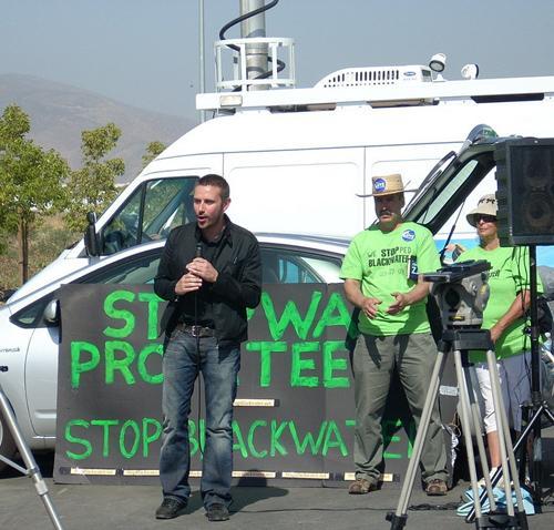 Journalist Jeremy Scahill speaks to Blackwater protestors in 2008.