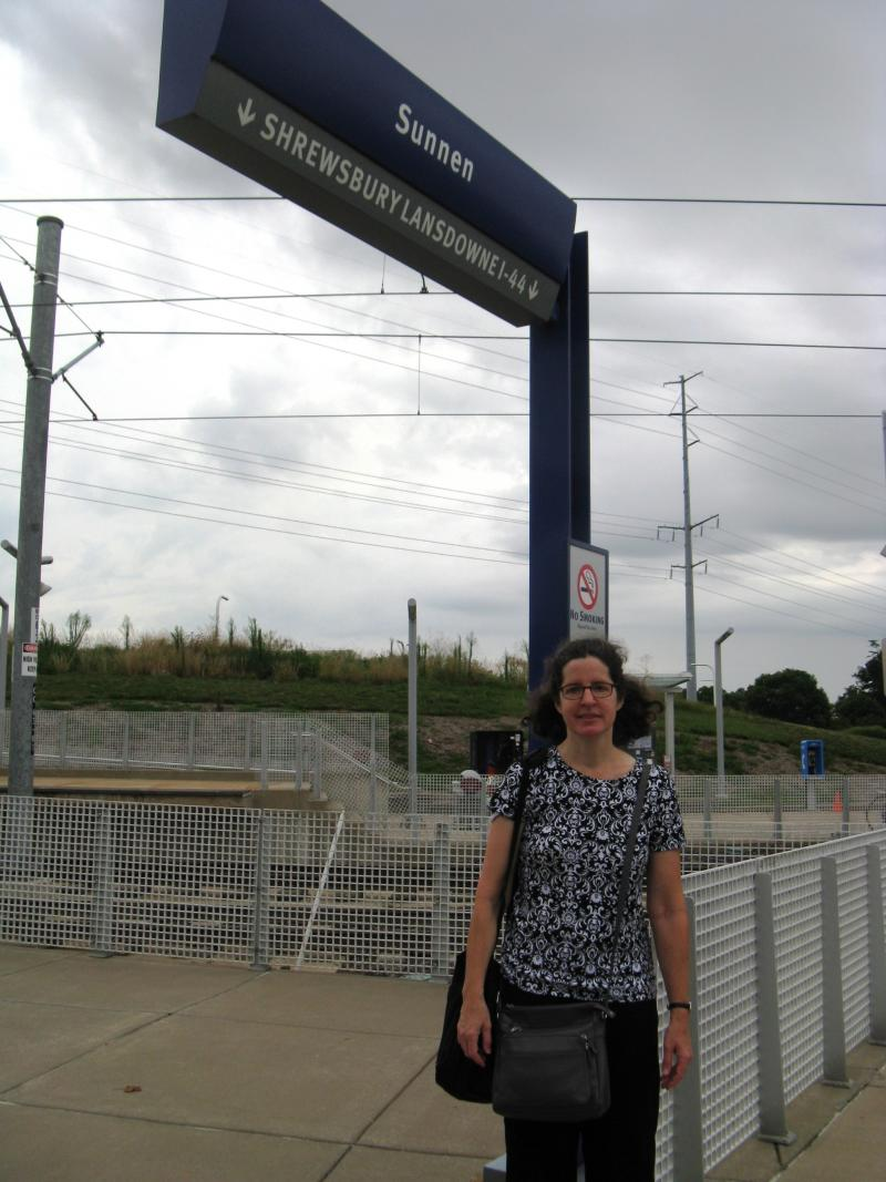 Kathleen Henry at the Sunnen MetroLink station.  She says the South County Connector would make her walk from her home to the station much less enjoyable.