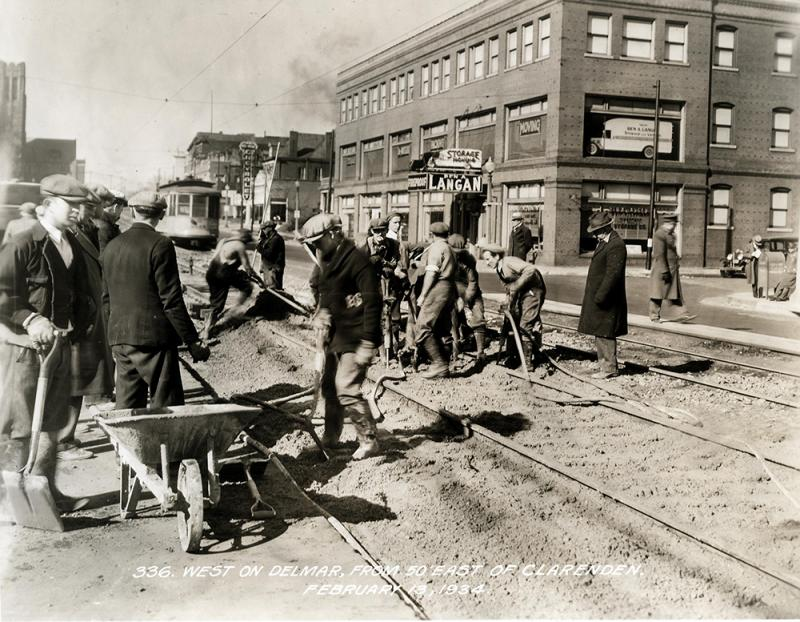 Working on the tracks on Delmar east of Clarenden in February 1934. This is a few blocks east of where the proposed Loop Trolley would run.
