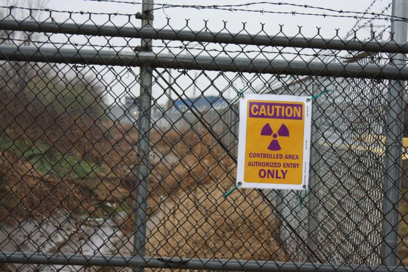 Radiation warning sign posted on the West Lake Landfill perimeter fence in Bridgeton, Mo.