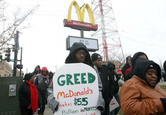 Workers demonstrate in support of a higher minimum wage.