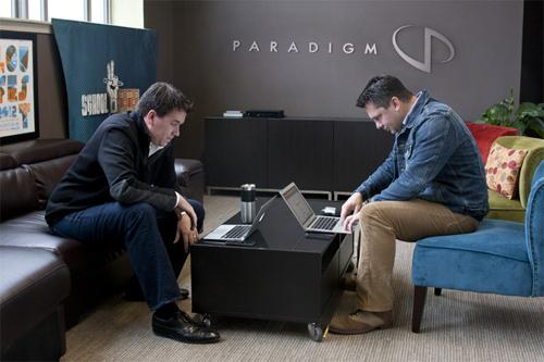 Vance Crowe of Articulate Ventures (left) and Michael Huber of Paradigm New Media complete a Bitcoin transaction.