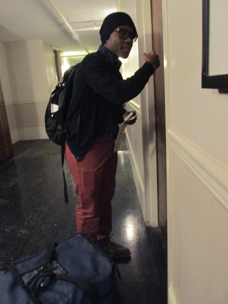 """""""Campus Kitchen!"""" calls out sophomore Juno Musonda after knocking on the door of a Campus Kitchen client who live at Grand View."""