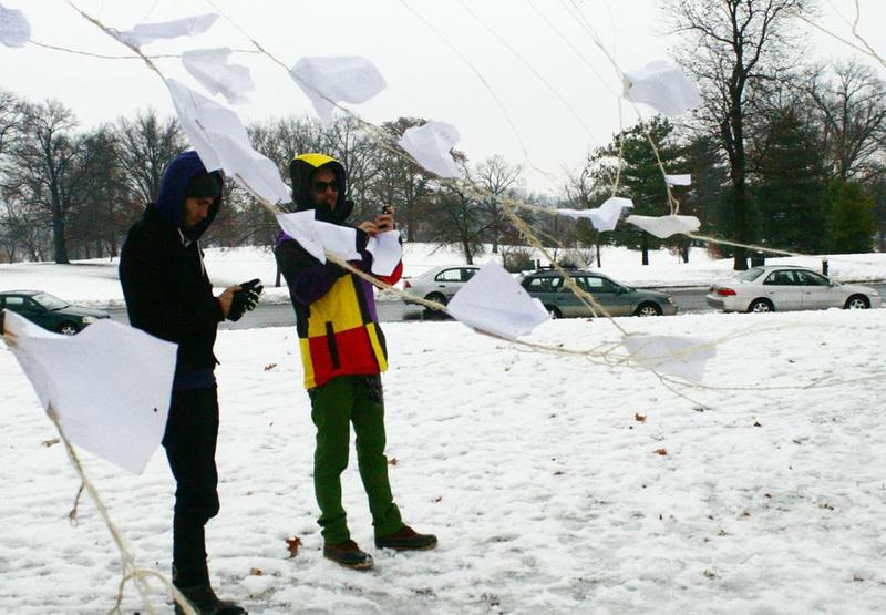 Kelly Crittenden and Kevin Chuck photograph the scene of The Poetree Project, just south of the St. Louis Art Museum. A timely snow on Friday night brought sledders as well as poetry fans  to check out the installation.