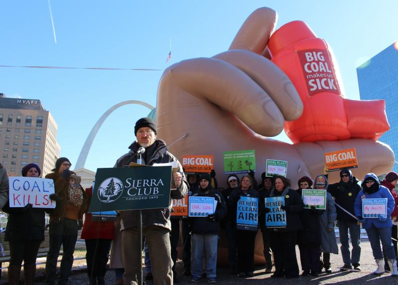 The Sierra Club's Andy Knott speaks at a rally on Thursday in front of a 15-foot tall inflatable inhaler in Keiner Plaza.