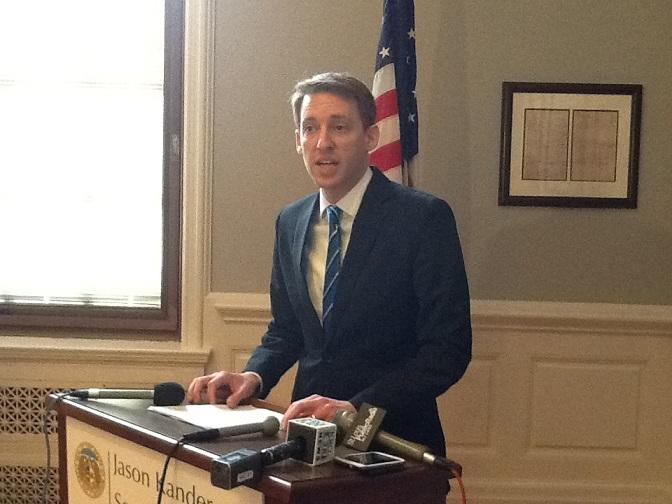 Mo. Sec. of State Jason Kander, D, unveils his ethics proposal to reporters at the Mo. Capitol.