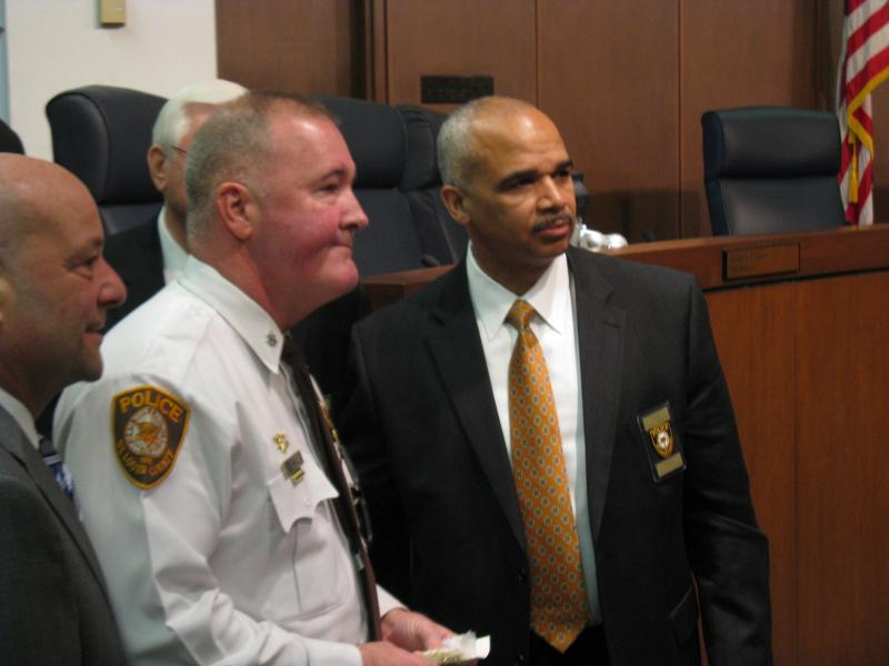 New County police chief Jon Belmar (center) after the announcement of his promotion on Jan 31, 2014.