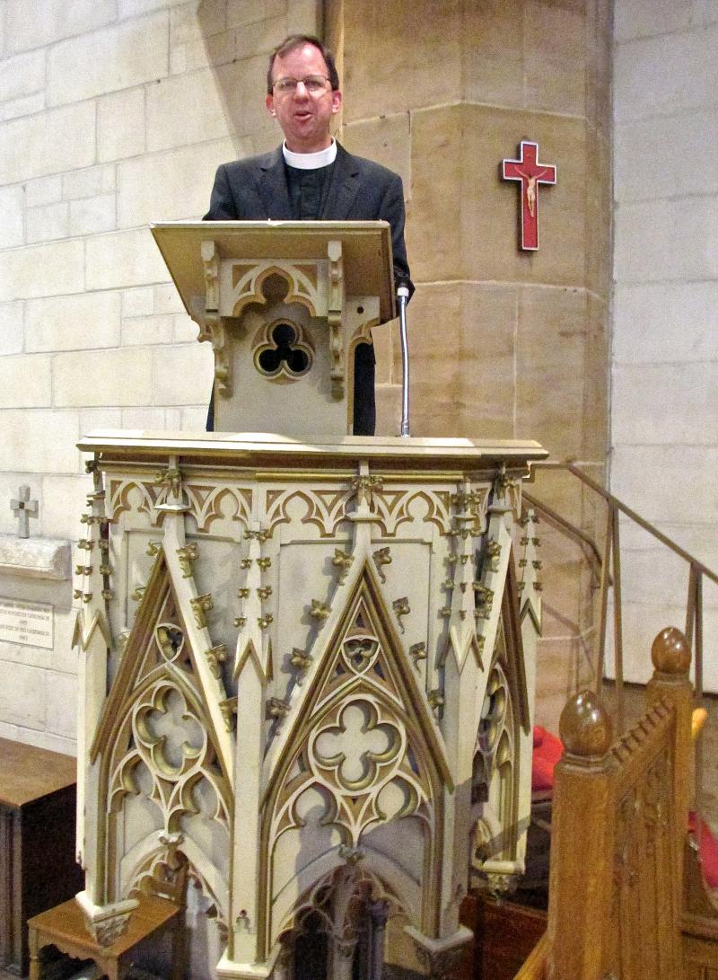 The Very Rev. Mike Kinman, dean of Christ Church Cathedral, at the pulpit where Dr. Martin Luther King spoke 50 years ago.