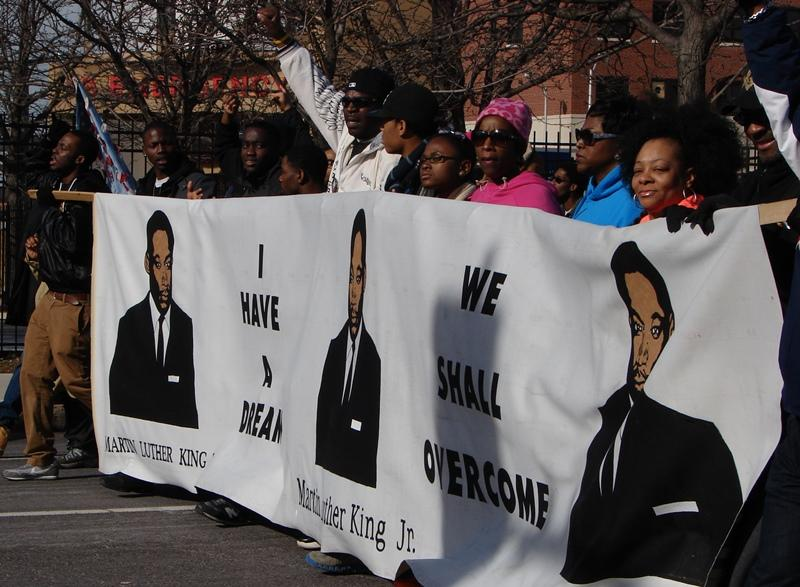 Marchers celebrate Martin Luther King Jr. on Grand Blvd. outside Powell Hall.