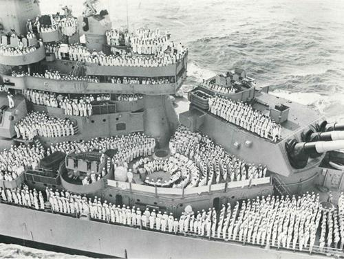 "Caption reads: ""On the fourth anniversary of V.J. Day in 1949, Missouri crewmen took part in a commeration ceremony."""