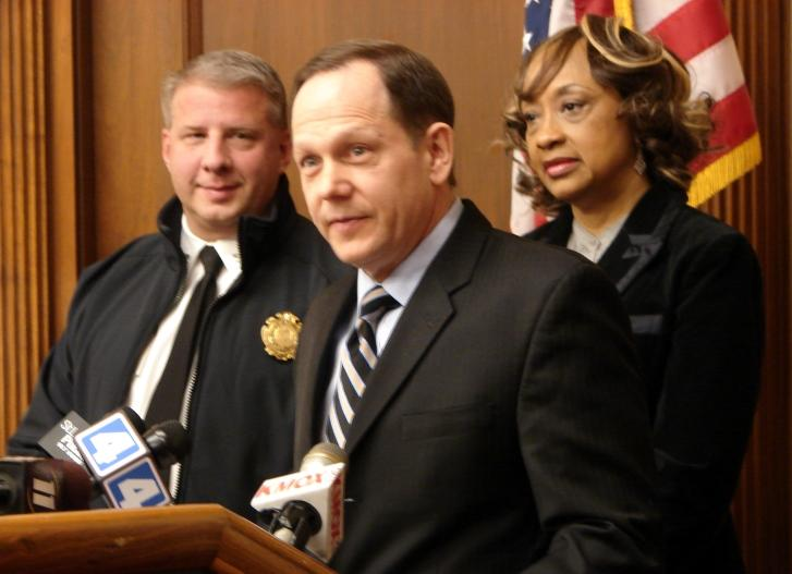St. Louis Mayor Francis Slay (center) urges homeless residents to seek shelter before sub-zero temperatures arrive.
