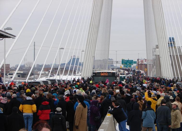 Throngs of Illinois and Missouri residents brave a cold Saturday afternoon to attend the ribbon-cutting ceremony on the Stan Musial Veterans Memorial Bridge.