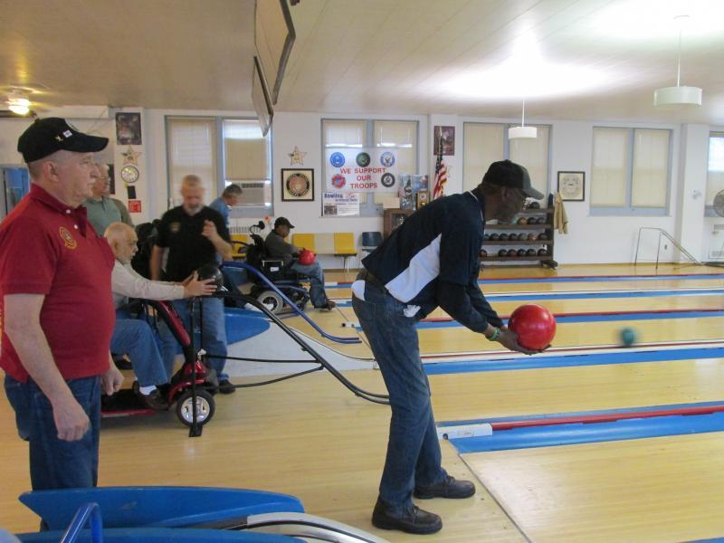 Veteran Mitch Harris practices his aim. The lanes serve St. Louis VA medical center patients and outpatients.