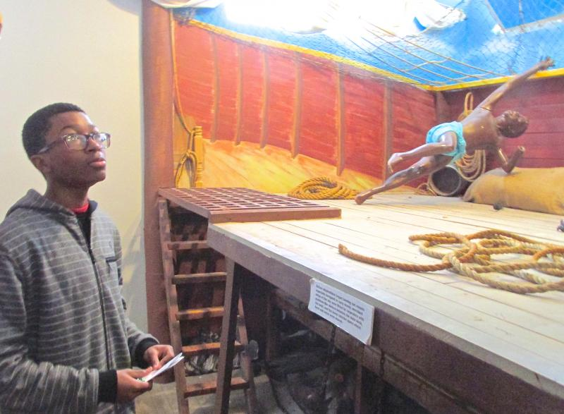 Jaryn Simms, an eighth-grader at KIPP Inspire Academy, was fascinated by the replica model of a slave ship.