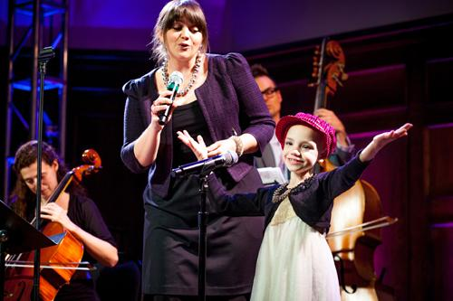 Singer Erin Bode performs with a Kids Rock Cancer patient at a benefit concert on May 22, 2013.