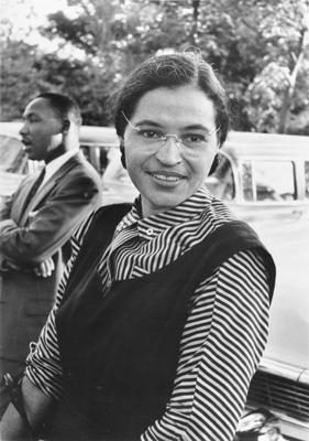 Rosa Parks circa 1955, with Martin Luther King Jr. in the background.