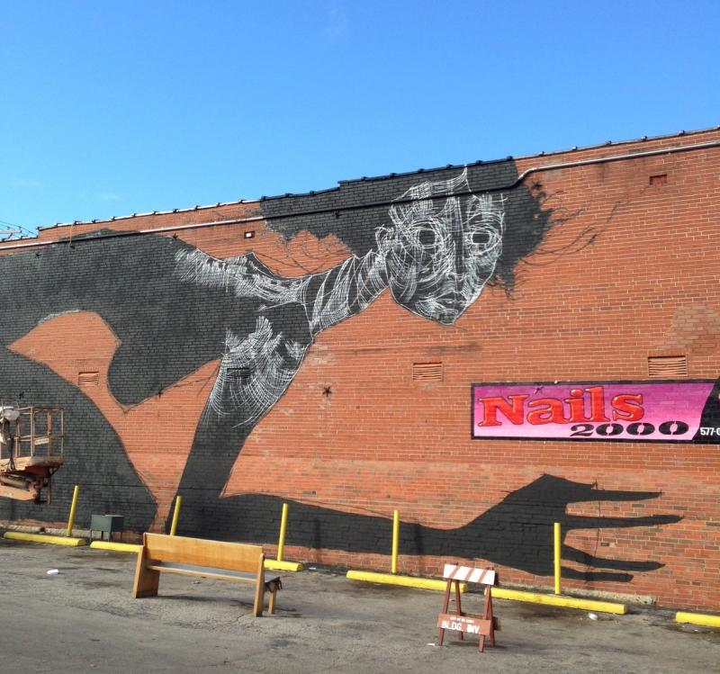 Faring Purth's mural in progress on Feb. 23 on the south side of the building at 3407 S. Jefferson Ave.