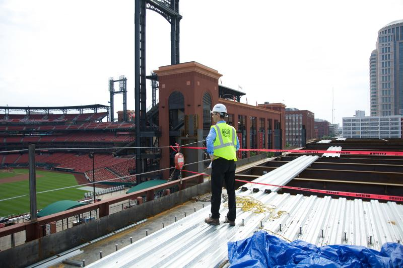William DeWitt III surveys construction of Ballpark Village