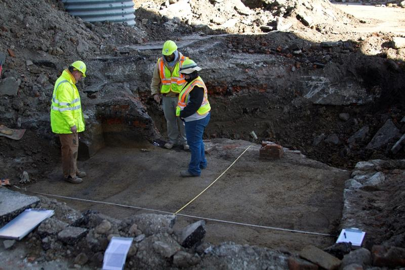 MoDOT archeologists survey an archeological dig site below the Poplar Street Bridge in St. Louis.
