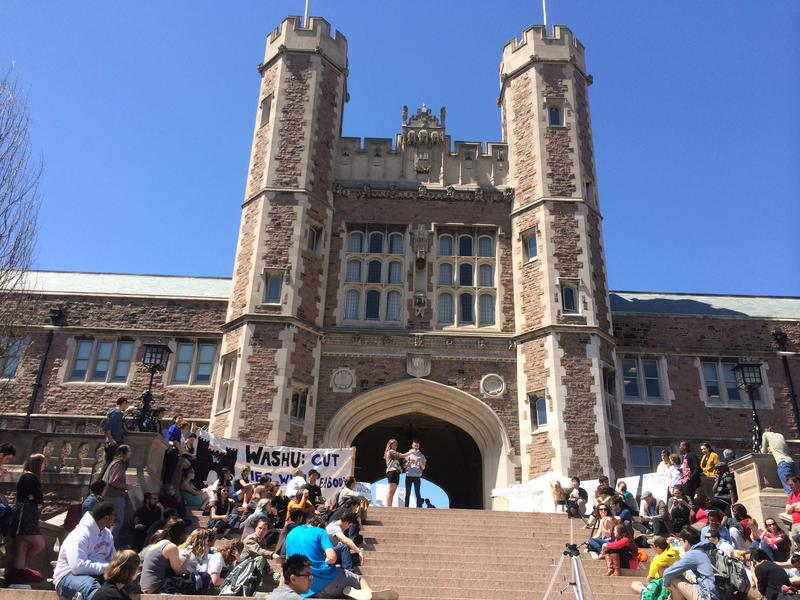 Protestors converge on the steps of Brookings Hall to protest Washington University's ties with Peabody.